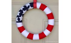 Use an American flag yarn wreath to welcome guest at your front or back door.