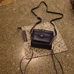 NWT Rebecca Minkoff navy cross body bag Brand new. Navy with gold hard wear. Comes with dust bag also. Neat small purse. Sold out most places. This was purchased at Nordstrom. Rebecca Minkoff Bags Crossbody Bags