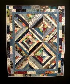 Another one of our recent quilts--this one was made from a collection of woman's clothing.