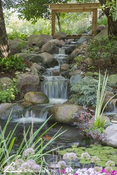 A backyard pond with running water, floating plants and darting fish can make a bland . How to build a pond takes work and planning. Backyard Water Feature, Ponds Backyard, Backyard Waterfalls, Pond Design, Landscape Design, Garden Design, Patio Design, Garden Waterfall, Pond Waterfall Kit