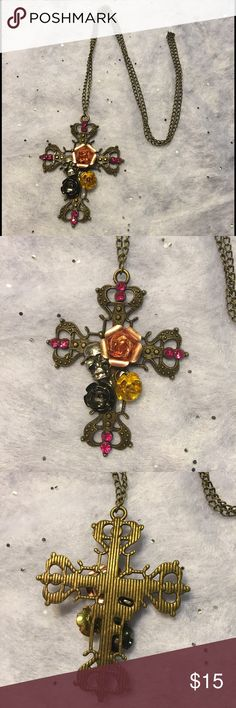 "Cross Skull Roses Necklace Pretty antique bronze cross and chain with pink rhinestones and a silver toned skull. It has a gunmetal colored rose, gold colored rose, and a copper toned rose. The cross is about 2.5"" long by 2"" wide. The chain does not have a clasp and slips over your head. It is about 24"" long. New in package. Jewelry Necklaces"
