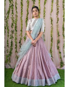 Stunning lavender color pattu lehenga and silver color crop top with ice blue color net dupatta. 07 February 2019 Buy Designer Collection Online : Call/ WhatsApp us on : Indian Lehenga, Half Saree Lehenga, Lehenga Dupatta, Lehenga Choli Designs, Designer Bridal Lehenga, Indian Wedding Outfits, Indian Outfits, Wedding Dress, Pakistani Outfits