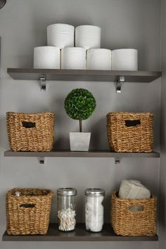 Take toilet paper out of the plastic and stack them. Baskets and glass canisters make storage stylish.