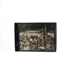 Black Pages Vintage photo album with a black and white picture of Tallinn Old Town on the cover. Small size retro photo album is perfect for travel photos or any other photos. Vintage travel photo album is made in Soviet Union. Black pages are good background for photos. Covers are made of faux leather. Very good condition, not used. 20 black pages. Size 26 x 17.5 cm (10.2 x 6.9 in).