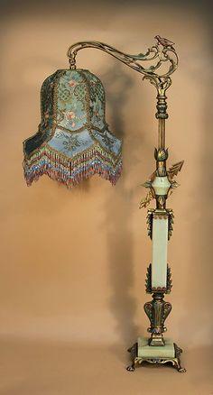 Ornate lotus bell shaped lamp and green jadite glass base