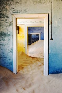 """Kolmanskop 24x36,"" blue and yellow surrealist photograph by artist Pieter Geevers 