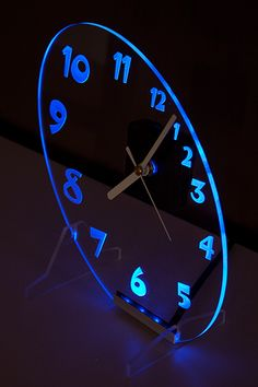 Clock with blue backlight LED in the oval shape.  New design.