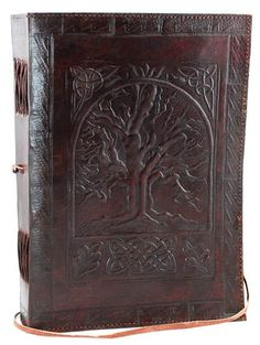 A beautiful journal that conveys a sense of age and mysticism, the large Tree of Life leather blank book is a beautiful journal whose cover features the hand tooled design of the tree of life framed b