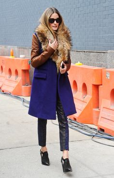 Olivia Palermo beats the cold in a fur collar purple coat and cropped leather pants