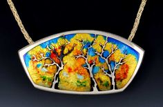This colorful forest with blue sky by Kristin Anderson looks magickal! Sterling Silver and Vitreous Enamel. \ http://www.kristinworks.com/portfolio/sterling-silver-custom-jewelry/