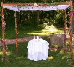 chuppah great use of flowers on the pole