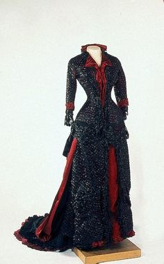 1880s Maria Feodorovna evening dress of black satin embroidered with silk threads and glass beads by Fromont, Paris (Hermitage)