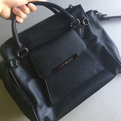 Steve Madden Black Crossbody Handbag Satchel Preowned, NO FLAWS, has a faint smoke smell (consider before purchasing), beautiful condition! Hardware is a gorgeous gray silver color. Great bag at a great price. Steve Madden Bags Crossbody Bags