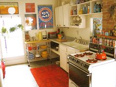 (when i have the money i want to invest in vintage 40's/50's kitchen)...but in the meantime, i really love this kitchen.  reminds me of being a kid