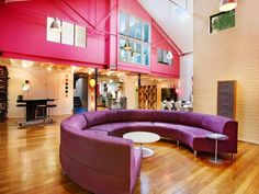 Pink wall, purple sofa, hardwood floors, loft apartment...so nice!