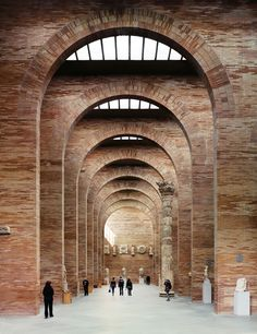 Rafael Moneo - Towering arches of thin Roman brick line the inside of the National Museum of Roman Art.