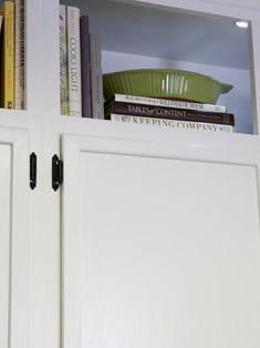 Above wall cabinets can be a great place to store those rarely used items in a kitchen, as seen on HGTV.com.