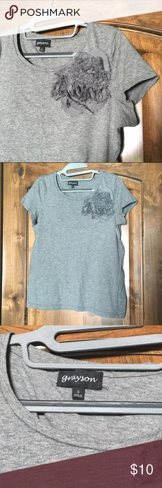 Floral accent tee Gray shirt, but oh so not boring. Large floral accent at top neckline to add that pizazz. Great condition. Has been washed and worn, but no specific flaws to mention. Grayson Tops Tees - Short Sleeve