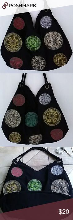 Just in! Polka Pop Tote Shoulder Bag NWOT Large Shoulder Bag or Tote. Black body decorated front and back with multiple, colorful stitch-decorated patches. Water resistant, zip closure, fully lined in blue, inside zip pocket. Dual handles. Gray faux leather polka dot patches decorated in red, yellow, mint green, cream, white, turquoise, and gold stitching. Likely handcrafted, beautiful construction. Extra large.  Textile art. Bags Shoulder Bags