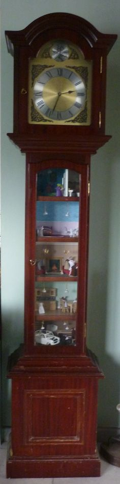 My Dollshouse, I bought a cheap, reproduction, longcase clock on eBay, took out the internal workings (that weren't working) put in a battery quartz movement and horizontal partitions for floors. And who would live in a clock, but mice - enter the families of Hickory and Dickory Dock