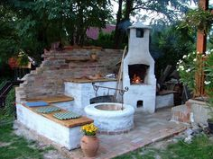 garden gathering place patio with fire pit/ oven created from old brick foundation