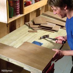 Leftover scraps of laminate flooring make a great workbench surface. Laminate is tough and easy to clean—dried glue or paint scrapes right off. If you fasten the laminate with small nails, you can easily pry it off and replace it every few years.