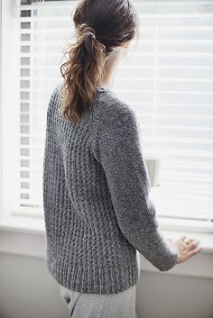 This cozy sweater is perfect for lounging on a Sunday morning, or throwing on for outings on chilly Fall or Winter days. The simple twisted- stitch texture pattern creates a wonderfully soft and squishy fabric for the body of the sweater, while the sleeves are worked in Reverse Stockinette Stitch. The raglan yoke makes this a casual and comfortable garment you'll find yourself reaching for over and over again.