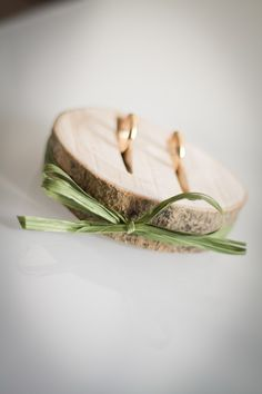 Love this idea - using a wooden stump as the ring bearer pillow!