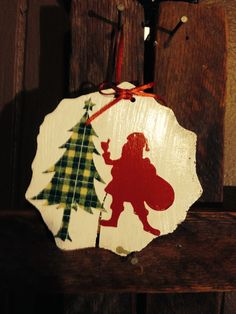 Santa with tree ornament made from wood slice
