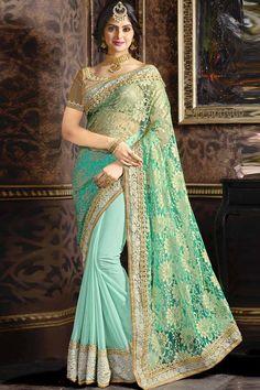 Sky Blue Net And Art Silk Saree With Art Silk Blouse Prix: 79,63 €   Blue Sky net et de l'art sari de soie avec de la crème chemisier en soie d'art .  Agrémentée de Resham , Zari et broderies de pierre. Saree avec imprimé Pallu et Border Lace , U Neck Blouse , manches courtes Blouse . Il est livré avec un chemisier disjoindre , il peut être cousu à 34,36,38,40 tailles .  http://www.andaazfashion.fr/womens/sarees/sky-blue-net-and-art-silk-saree-with-art-silk-blouse-dmv9129.html