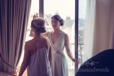 Bridesmaid sprays perfume at Italian Villa wedding photographs.Photography by one thousand words wedding photographers