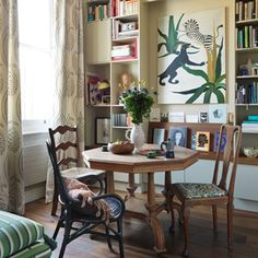 Floor to ceiling bookshelves add visual impact and character in the London home of this interior designer