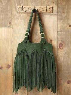 The fringe and the hunter green color. LOVE! #FreePeople