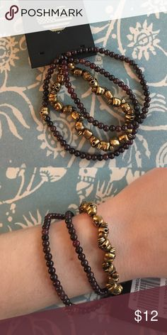 Brandy Melville Bracelet Set Set of three bracelets from Brandy Melville-- two strands with dark garnet-colored beads and one with gold skull beads. Never worn Brandy Melville Jewelry Bracelets