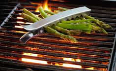 This set of four Sur La Table Grill Clips is sure to make your grilling easier. The easy to use clips are great for grilling the perfect asparagus, zucchini, Cool Kitchen Gadgets, Cool Gadgets, Kitchen Tools, Cool Kitchens, Cheap Gadgets, Unique Gadgets, Kitchen Time, Latest Gadgets, Kitchen Supplies