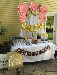 Lee's Bridal Shower: Pink and gold mimosa bar with DIY paper flowers and bubbly bar banner! #diypartysigns