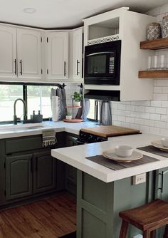5th Wheel Kitchen remodel with green cabinets Featuring @karleemmarsh on MountainModernLife.com rvrenovation #rvforsale #rvmakeover #blackshiplap #concretecounters #greenkitchencabinets #tinyhome #tinyhomeonwheels #camper #camperforsale #designvibes #rvreno #rvremodel #rvinspiration #rvdecor #campermakeover