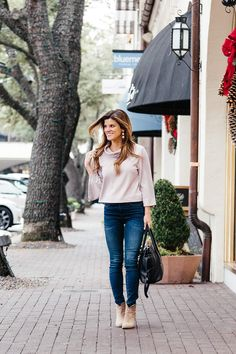 pink cowl neck sweater, frame denim high rise jeans, vince camuto suede ankle booties, jeans tucked into booties, baublebar crispin earrings