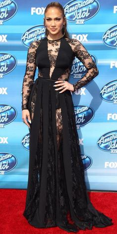 Look of the Day May 14, 2015 Jennifer Lopez wowed at the American Idol XIV Grand Finale Show in a sheer black lace paneled Zuhair Murad bodysuit with a matching evening skirt.