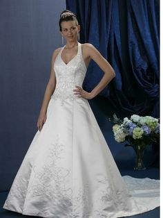 This halter wedding gown has a sweetheart neckline paired with the princess line silhouette.