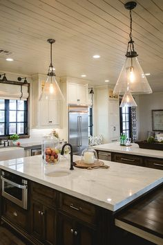 The glass cone lighting is Rosedale Pendant from Ethan Allen – $480
