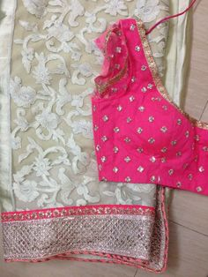 White Net Saree with cut work border and sequins pink border paired with Pink Sequins Blouse