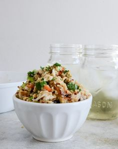 Thai chicken quinoa bowl ingredients: 1/2 cup uncooked quinoa, rinsed 1 chicken breast, cooked and shredded 1/3 cup chopped carrots 1/3 cup shelled edamame 1/3 cup chopped green onions 1/4 cup chopped peanuts 1/4 cup freshly chopped cilantro