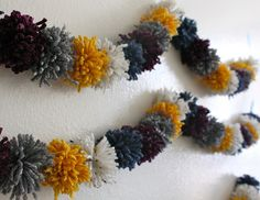pom pom garlands..need to remember to make these in fuschia, yellow and lime green