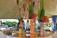 Moroccan theme decor idea. Copper lanterns and strings of flowers hung from the tent.
