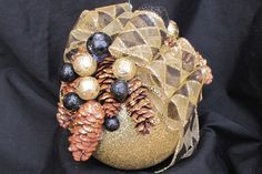 Large Christmas ornament decorated with pine cones and miniature decorations