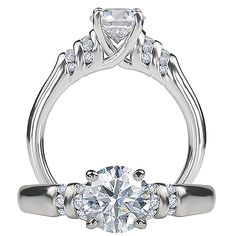 Ritani Classic diamond engagement ring featuring a prong set round cut center stone with micropavé diamonds and a solid metal shank.