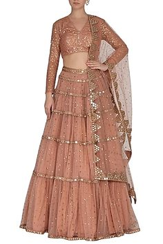 Featuring a dusty rose gathered lehenga skirt in net base with sequins scatter hand embroidery. It is paired with matching blouse and dupatta having mirror border. FIT: Fitted at bust and waist. CARE: Dry clean only. Indian Fashion Designers, Indian Designer Wear, Lehenga Skirt, Pink Lehenga, Anarkali Dress, Anarkali Suits, Lehenga Choli, Indian Gowns Dresses, Shadi Dresses