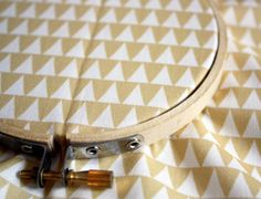geometric triangle fabric - gold & white via boosterseat | etsy. $12.00