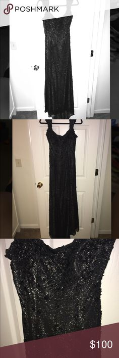 Mike Benet Formals Black Gown w/ Black Shawl I wore this dress to a dance many years ago but it is still in great condition. It has a fun sparkle layer underneath which gives the dress it's sparkle. It also has a great intricate beading design on the dress(I noticed only a couple of beads missing, nothing noticeable.) It snaps on the left shoulder and also zips on that side. I did have cups put in as well as a bustle but the dress itself is a size 8. Mike Benet Formals Dresses Prom